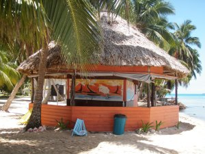Kick back with a cold one at this beach-side bar in Belize!